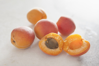 Close-up of peaches on white background