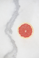 Close-up of half grapefruit on white background
