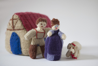 Woolen people with dog and house over white background