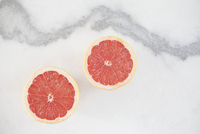 Directly above shot of sliced grapefruit on white background