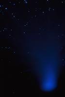 Illuminated fiber optic over black background