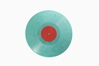 Close-up of blue record against white background