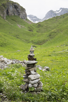 Stones stacked on grassy mountain