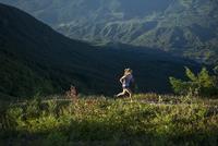 Woman running on mountain path