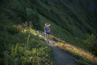 Full length of woman jogging on mountain path