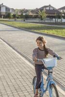 Girl cycling on footpath