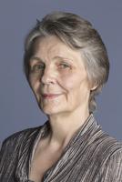 Portrait of smiling senior woman against purple background