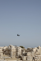 Helicopter flying over old ruins