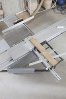 High angle view of lumber on sliding table saw in workshop
