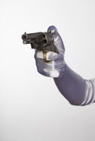 Bride's hand holding handgun against white background