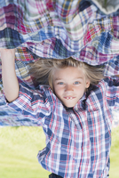 Upside down image of boy practicing headstand at backyard
