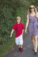 Mother and son walking on street