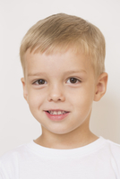Portrait of cute boy against white background