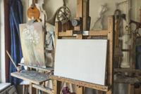 Canvas on easel in art studio