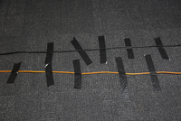 High angle view of cables attached on carpet