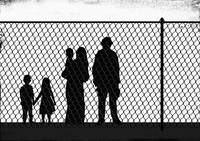 Silhouette family standing in front of fence