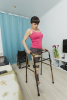 Disabled woman walking with mobility walker at home 11016032399| 写真素材・ストックフォト・画像・イラスト素材|アマナイメージズ