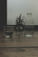 Close-up of water and plant in glass containers on table