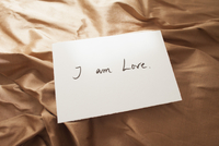 Close-up of love card on fabric