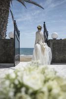 Rear view of bride walking towards beach