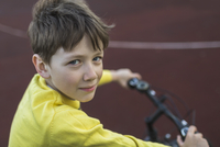 Portrait of smiling boy cycling outdoors