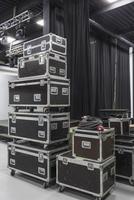 Stack of audio equipment boxes in studio