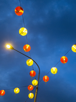 Low angle view of illuminated Chinese lanterns hanging against sky