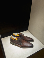 High angle view of brown shoes on shelf for display in store