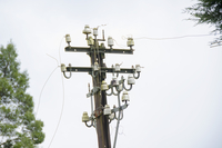 Low angle view of damaged electricity pole against clear sky