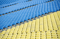 Full frame shot of empty yellow and blue seats at stadium