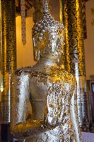 Foil on Buddha statue in temple