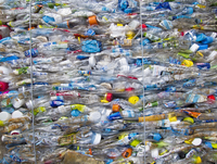 Full frame shot of crushed plastic bottles at garbage dump