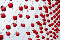 Tilt image of red Chinese lanterns hanging against sky