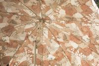 Adjustable floral patterned parasol