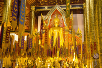 Prayer flags against Buddha statues in Wat Chedi Luang temple