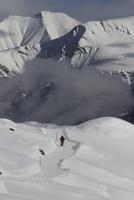 Person skiing on snow covered mountain 11016033096| 写真素材・ストックフォト・画像・イラスト素材|アマナイメージズ