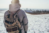 Rear view of hiker standing on snow covered landscape 11016033310| 写真素材・ストックフォト・画像・イラスト素材|アマナイメージズ