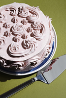 High angle view of creamy cake with spatula on table