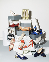 Various pair of shoes with boxes against white background