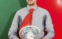 Midsection of businessman with sweaty armpits holding fan against colored background 11016033419| 写真素材・ストックフォト・画像・イラスト素材|アマナイメージズ