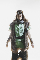 Portrait of furious woman wearing goggles and jacket standing against white background 11016033654| 写真素材・ストックフォト・画像・イラスト素材|アマナイメージズ
