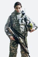 Portrait of soldier holding rifle and helmet standing against white background 11016033661| 写真素材・ストックフォト・画像・イラスト素材|アマナイメージズ