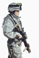 Side view of female soldier carrying rifle while standing against white background 11016033664| 写真素材・ストックフォト・画像・イラスト素材|アマナイメージズ