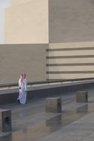Rear view of man walking on floor by railing 11016033693| 写真素材・ストックフォト・画像・イラスト素材|アマナイメージズ