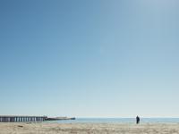 Boats moored by pier at beach against clear blue sky, S.S. Palo Alto, Aptos, California, USA