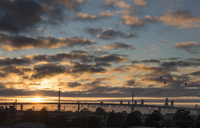 View of bridge and skyline against cloudy sky during sunset, Melbourne, Victoria, Australia