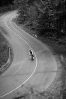 High angle view of cyclist riding bicycle on country road