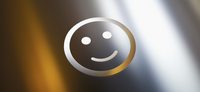 Close-up of smiley face against gray gradient background