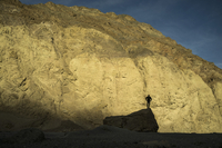 Silhouette of man standing on rock against mountain, Death Valley, Nevada, USA