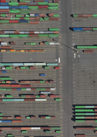 Aerial view of multi colored cargo containers at commercial dock